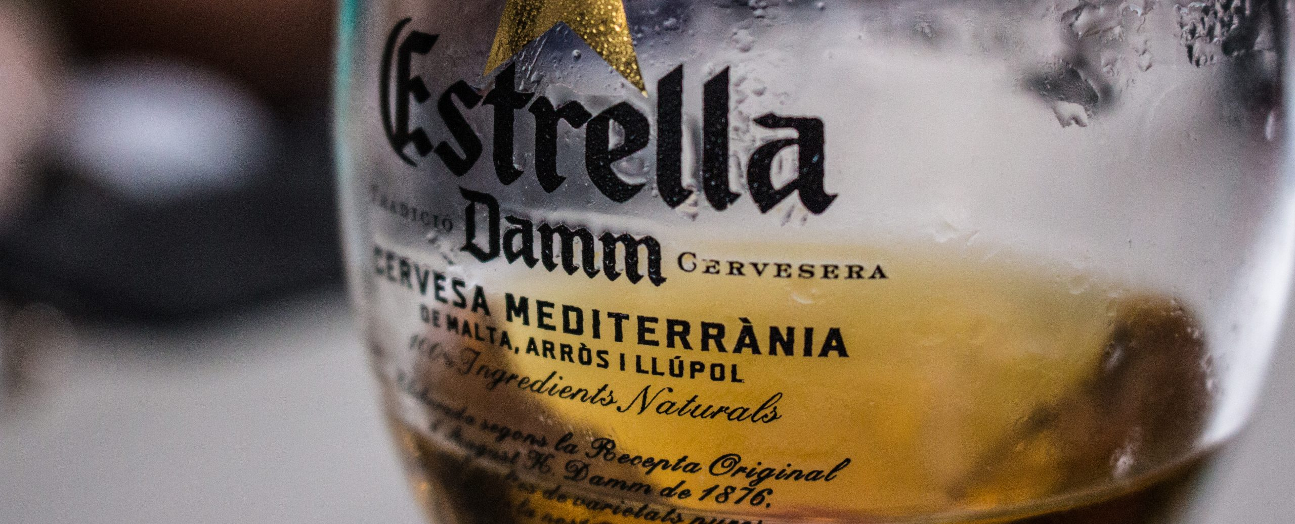 a glass of estrella beer in Tarragona