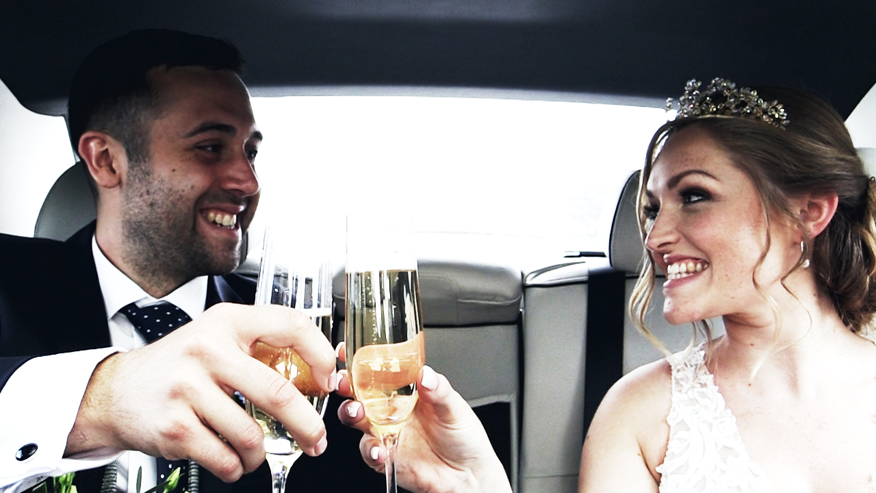 wedding films by marlyn pictures chrissie & adam toast in the wedding car