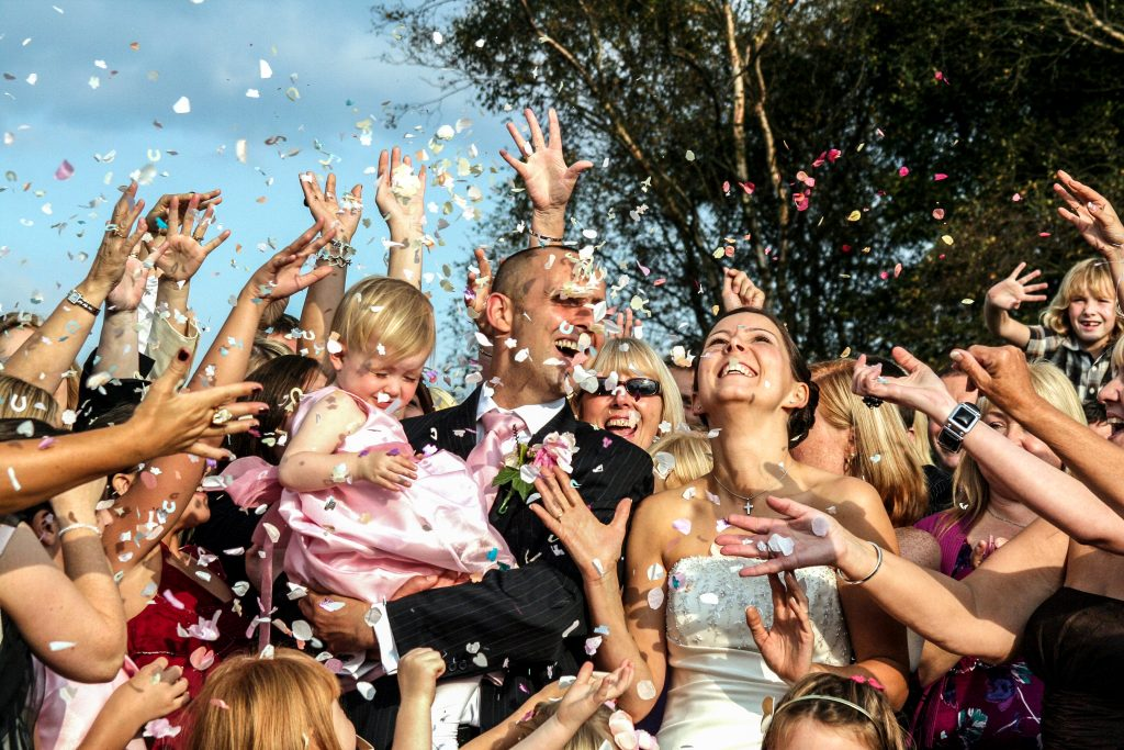 marlyn pictures wedding videography - happy couple confetti